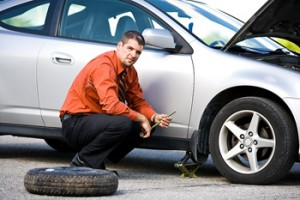 man changing the Flat Tyre