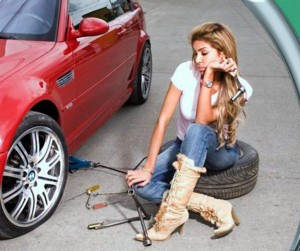 woman sitting on a tire